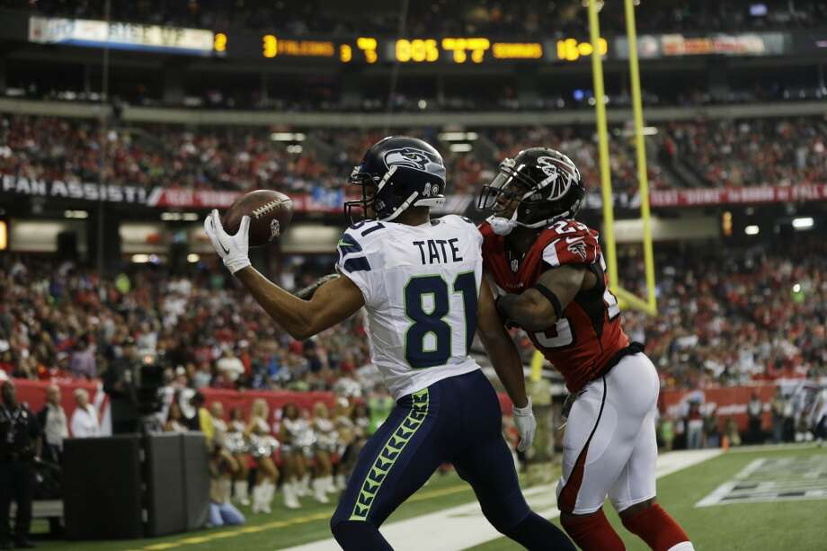 Seattle Seahawks wide receiver Golden Tate (81) makes a touch-down catch against Atlanta Falcons cornerback Robert Alford (23) during the first half of an NFL football game, Sunday, Nov. 10, 2013, in Atlanta. (AP Photo/John Bazemore) Photo: AP