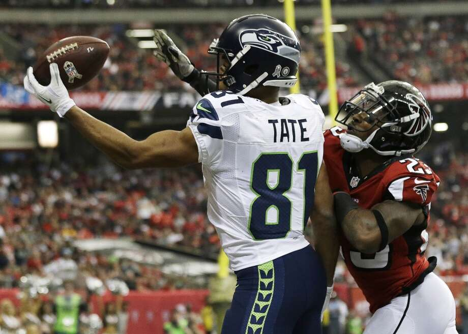 Seattle Seahawks wide receiver Golden Tate (81) makes a touch-down catch against Atlanta Falcons cornerback Robert Alford (23) during the first half of an NFL football game, Sunday, Nov. 10, 2013, in Atlanta. (AP Photo/John Bazemore) Photo: ASSOCIATED PRESS
