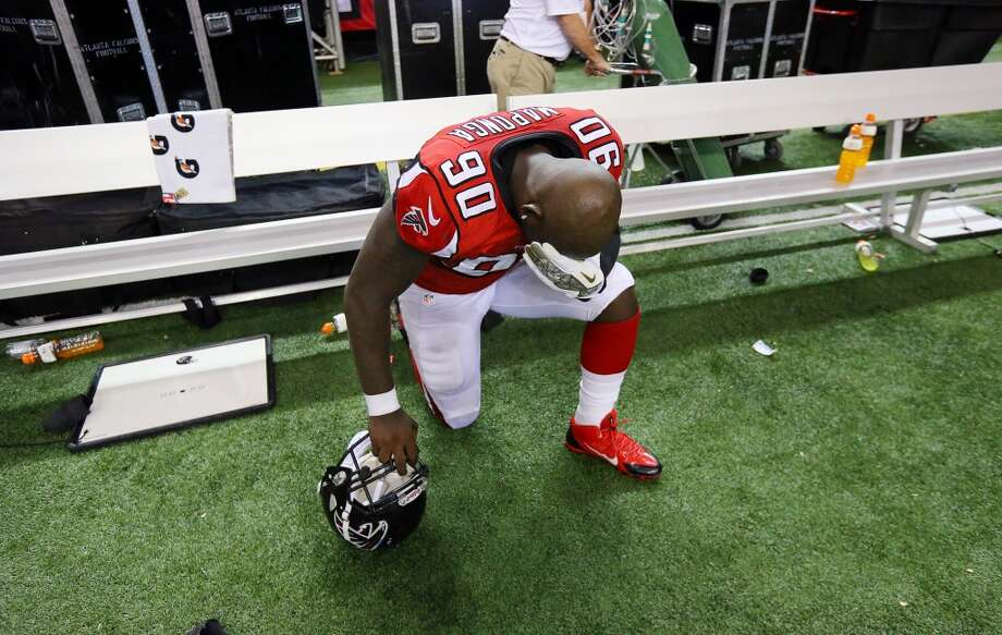 Atlanta Falcons defensive end Stansly Maponga kneels on the side line after an NFL football game against the Seattle Seahawks on Sunday, Nov. 10, 2013, in Atlanta. (AP Photo/Atlanta Journal-Constitution, Curtis Compton) MARIETTA DAILY OUT; GWINNETT DAILY POST OUT; LOCAL TV OUT; WXIA-TV OUT; WGCL-TV OUT Photo: AP