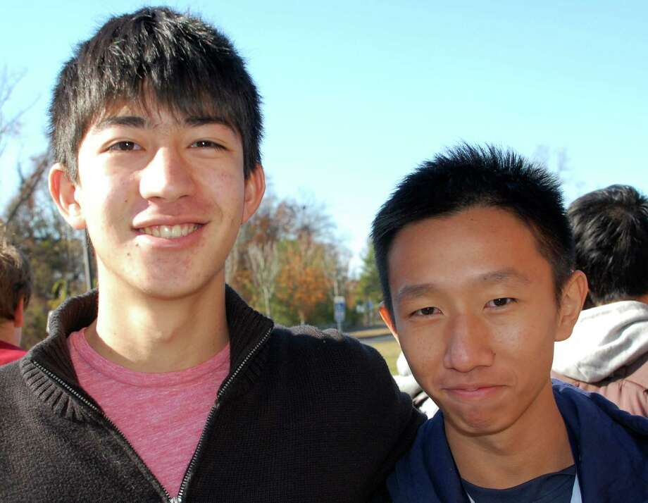 Warren Schoor, 18, left, a senior at Staples, with Hao Wei Goh, 16, who will stay with Schoor's family during an exchange visit over the next two weeks. Schoor was one of the two Staples students who went to Singapore last year. Photo: Jarret Liotta / Westport News contributed