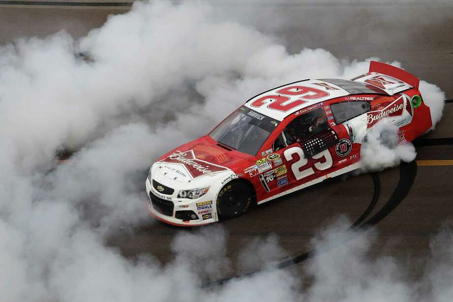 AVONDALE, AZ - NOVEMBER 10:  Kevin Harvick, driver of the #29 Budweiser Chevrolet, celebrates with a burnout after winning the NASCAR Sprint Cup Series AdvoCare 500 at Phoenix International Raceway on November 10, 2013 in Avondale, Arizona.  (Photo by Todd Warshaw/Getty Images) ORG XMIT: 159337948 Photo: Todd Warshaw / 2013 Getty Images