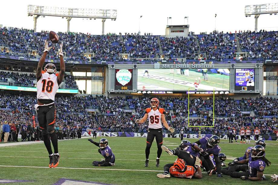 BALTIMORE, MD - NOVEMBER 10: Wide receiver A.J. Green #18 of the Cincinnati Bengals catches a batted ball for a touchdown against the Baltimore Ravens in the fourth quarter at M&T Bank Stadium on November 10, 2013 in Baltimore, Maryland. The Baltimore Ravens won, 20-17, in overtime. (Photo by Patrick Smith/Getty Images) ORG XMIT: 184890173 Photo: Patrick Smith / 2013 Getty Images