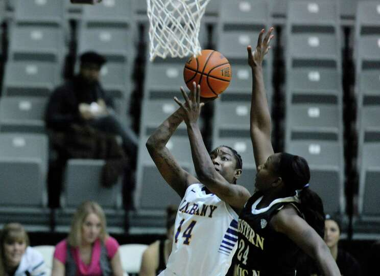Tammy Phillip, left, of UAlbany puts up a shot over Miracle Woods of Western Michigan during the UAl