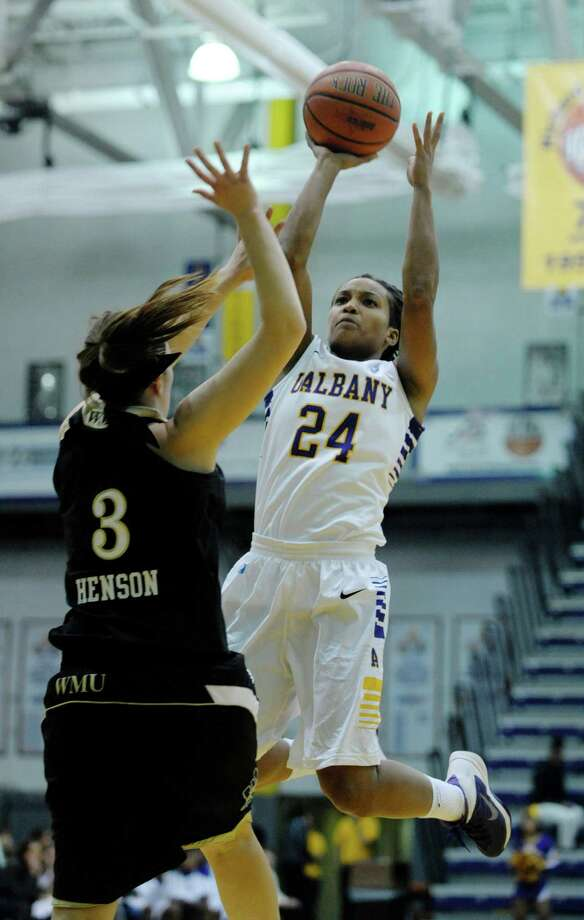 Keyontae Williams, right, of UAlbany puts up a shot over Julia Henson of Western Michigan during the UAlbany, Western Michigan women's basketball game at the SEFCU Arena on Sunday, Nov. 10, 2013 in Albany, NY.  (Paul Buckowski / Times Union) Photo: Paul Buckowski / 00024576A
