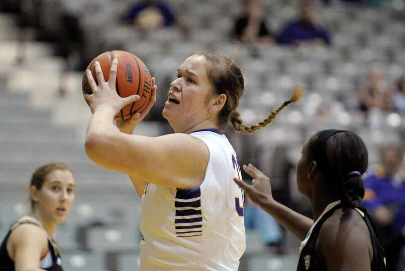 Megan Craig, left, of UAlbany makes a move towards the basket during the UAlbany, Western Michigan w