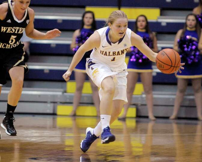 Erin Coughlin of UAlbany collects a loose ball during the UAlbany, Western Michigan women's basketba