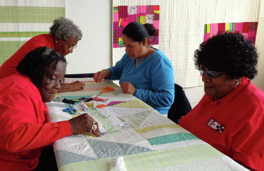 Members of Peace by Piece, a quilting group from Norwalk, demonstrated their craft while participating in an old-fashioned quilting bee Saturday at the Bridgeport studio of professional quilter Denyse Schmidt. They are Viola Sears, left front, who at 84 is the group's senior member; Ernestine Cobb, behind her, 79; Betty Mungo, right front, 75, and Juana Contreras, all of Norwalk. Photo: Meg Barone / Norwalk Citizen contributed