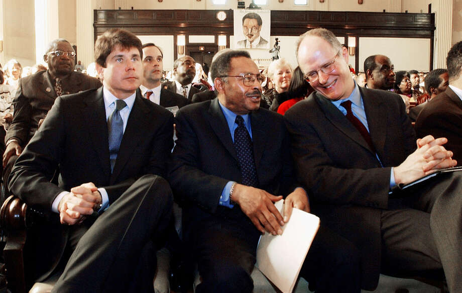 Illinois Democratic gubernatorial hopefuls Roland Burris, center, and Paul Vallas, right, talk as Rep. Rod Blagojevich, D-Ill., left, looks to the stage at Rainbow/PUSH Coalition, where they had a debate Saturday, Feb. 9, 2002, in Chicago. Photo: STEPHEN J. CARRERA, AP Photo/Stephen J. Carrera / AP2002Associated Press