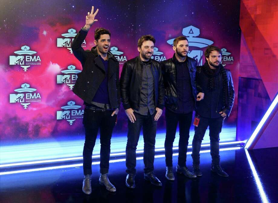 Members of Brazilian rock band Fresno pose as they arrive to attend the MTV European Music Awards (EMA) 2013 at the Ziggo Dome on November 10, 2013 in Amsterdam. Photo: ROBIN VAN LONKHUIJSEN, Getty Images / AFP