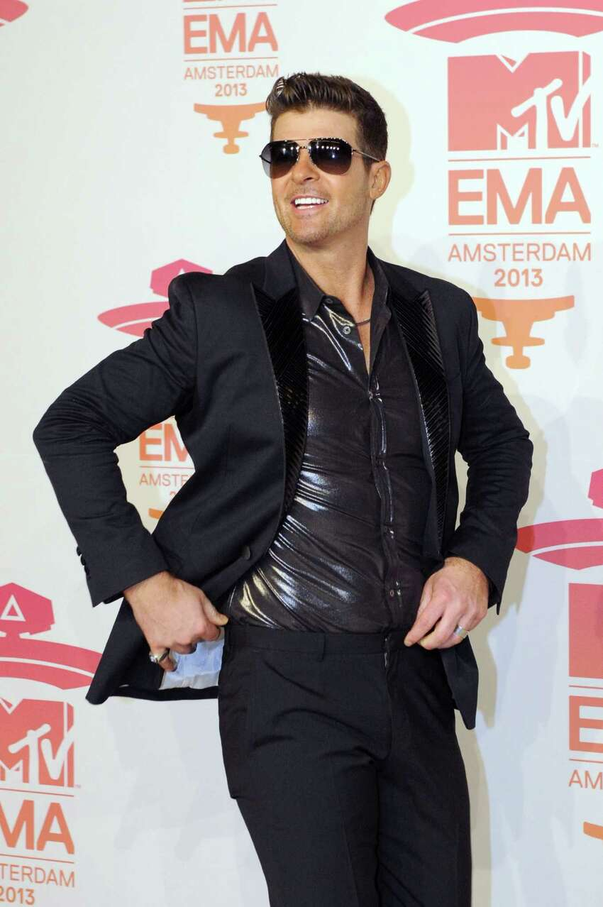 US-Canadian singer Robin Thicke poses as he arrives to attend the MTV European Music Awards (EMA) 2013 at the Ziggo Dome on November 10, 2013 in Amsterdam, The Netherlands.