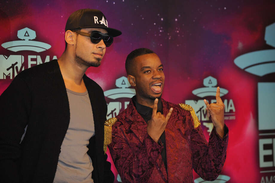 Dutch DJ Afrojack (L) and guest pose as they arrive to attend the MTV European Music Awards (EMA) 2013 at the Ziggo Dome on November 10, 2013 in Amsterdam, The Netherlands. Photo: JOHN THYS, Getty Images / AFP
