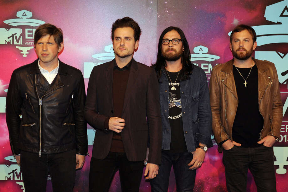 Members of US rock band Kings of Leon (from L to R) Matthew Followill, Jared Followill, Nathan Followill and Caleb Followill pose as they arrive to attend the MTV European Music Awards (EMA) 2013 at the Ziggo Dome on November 10, 2013 in Amsterdam, The Netherlands. Photo: JOHN THYS, Getty Images / AFP