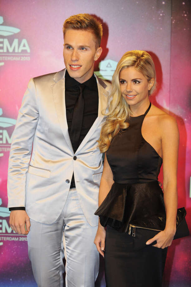 Dutch DJ Nicky Romero (L) and guest pose as they arrive to attend the MTV European Music Awards (EMA) 2013 at the Ziggo Dome on November 10, 2013 in Amsterdam, The Netherlands. Photo: JOHN THYS, Getty Images / AFP