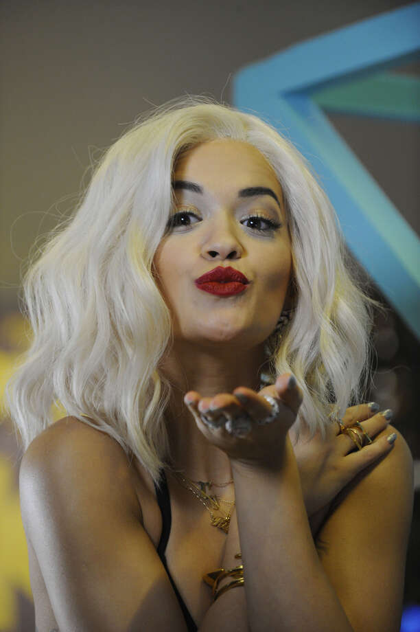 British singer Rita Ora poses as she arrives to attend the MTV European Music Awards (EMA) 2013 at the Ziggo Dome on November 10, 2013 in Amsterdam, The Netherlands. Photo: JOHN THYS, Getty Images / AFP
