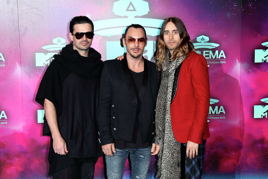 From left, Tomo Milicevic, Shannon Leto and Jared Leto from alternative rock band Thirty Seconds To Mars pose for photographers upon arrival at the 2013 MTV Europe Music Awards, in Amsterdam, Netherlands, Sunday, Nov. 10, 2013. Photo: Joel Ryan, Associated Press / Invision