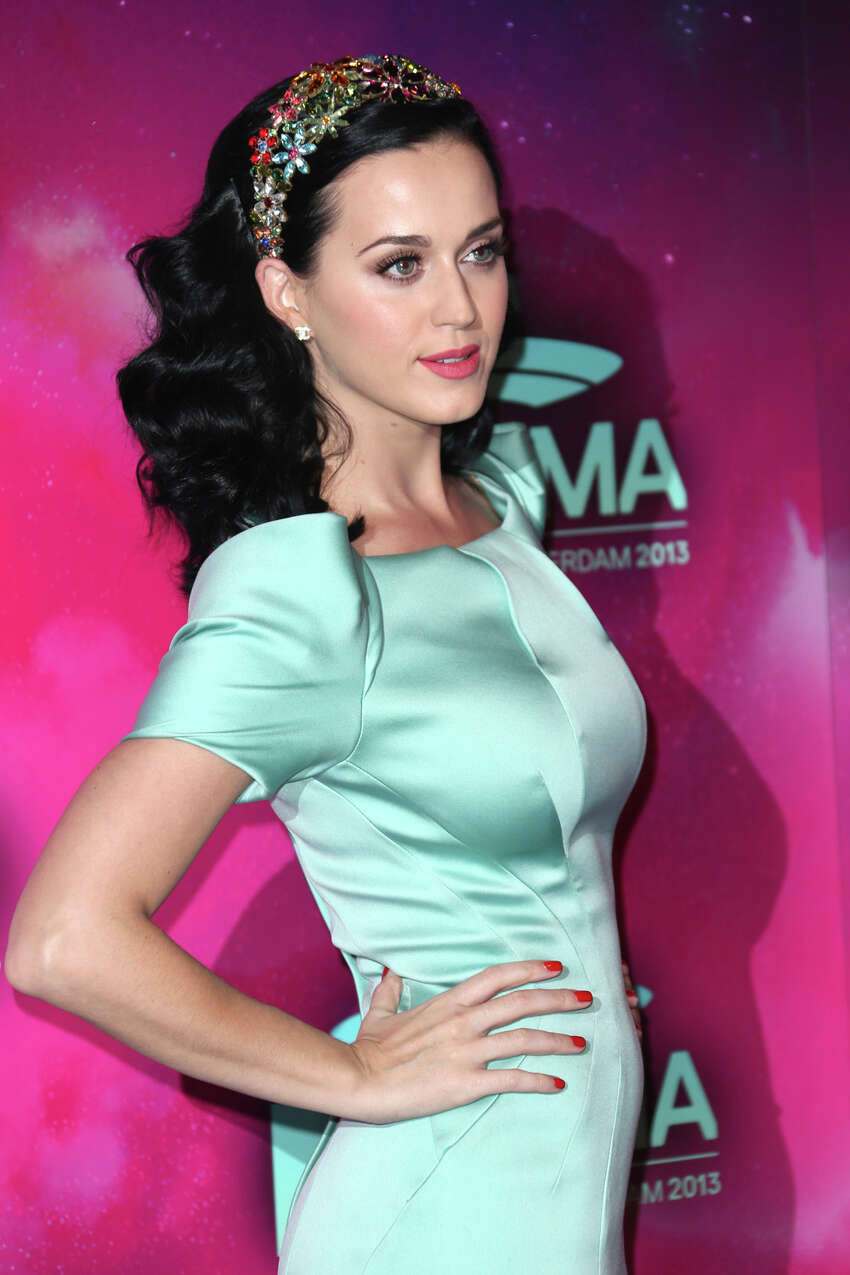 Katy Perry poses for photographers upon arrival at the 2013 MTV Europe Music Awards, in Amsterdam, Netherlands, Sunday, Nov. 10, 2013.
