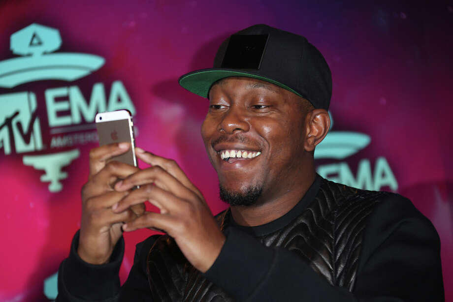 Dizzee Rascal takes a picture of photographers upon arrival at the 2013 MTV Europe Music Awards, in Amsterdam, Netherlands, Sunday, Nov. 10, 2013. Photo: Joel Ryan, Associated Press / Invision