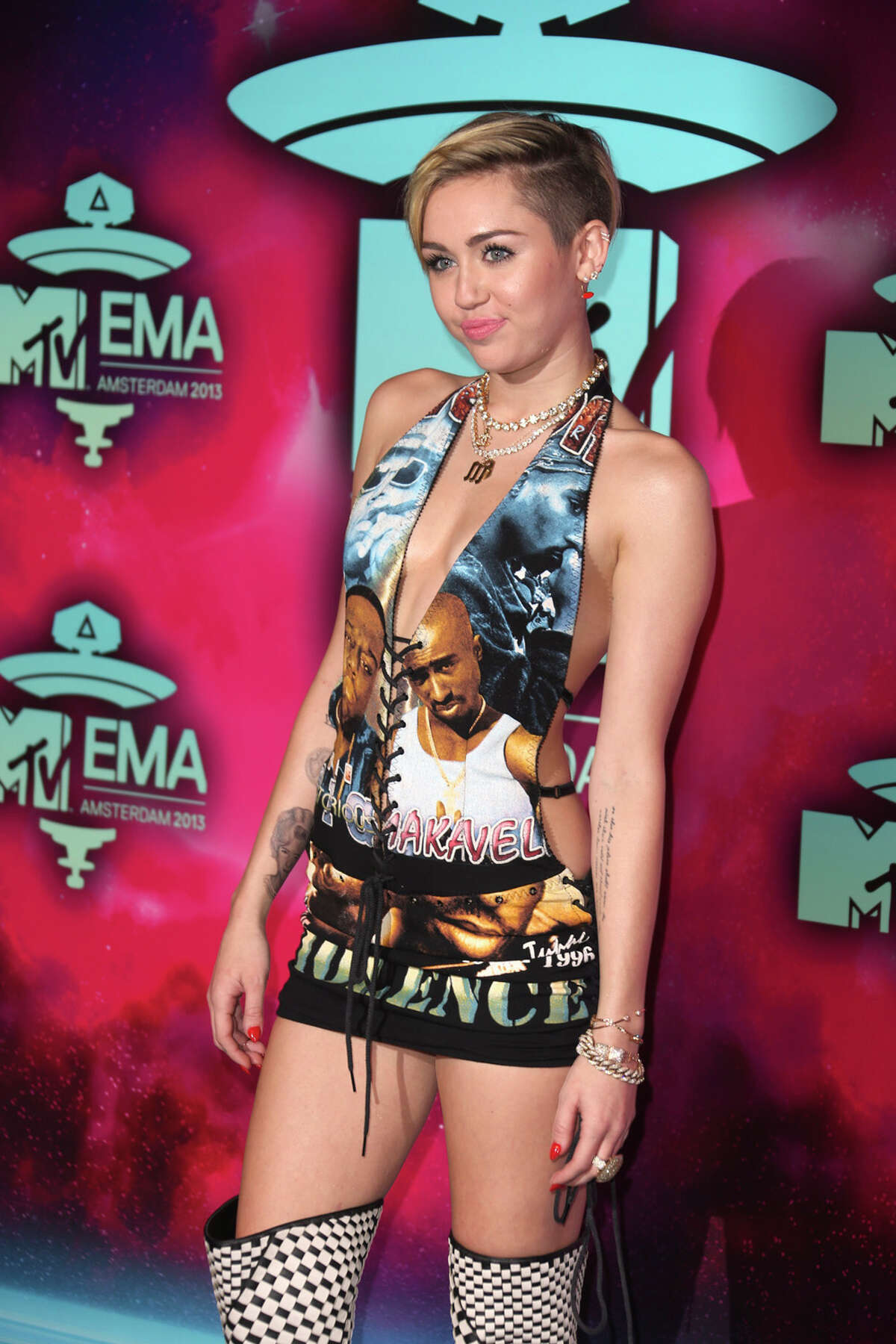 Miley Cyrus poses for photographers upon arrival at the 2013 MTV Europe Music Awards, in Amsterdam, Netherlands, Sunday, Nov. 10, 2013.