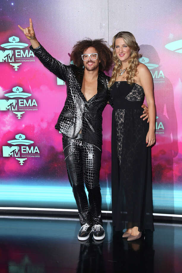 Redfoo, left, and Victoria Azarenka pose for photographers upon arrival for the 2013 MTV Europe Music Awards, in Amsterdam, Netherlands, Sunday, Nov. 10, 2013. Photo: Joel Ryan, Associated Press / Invision