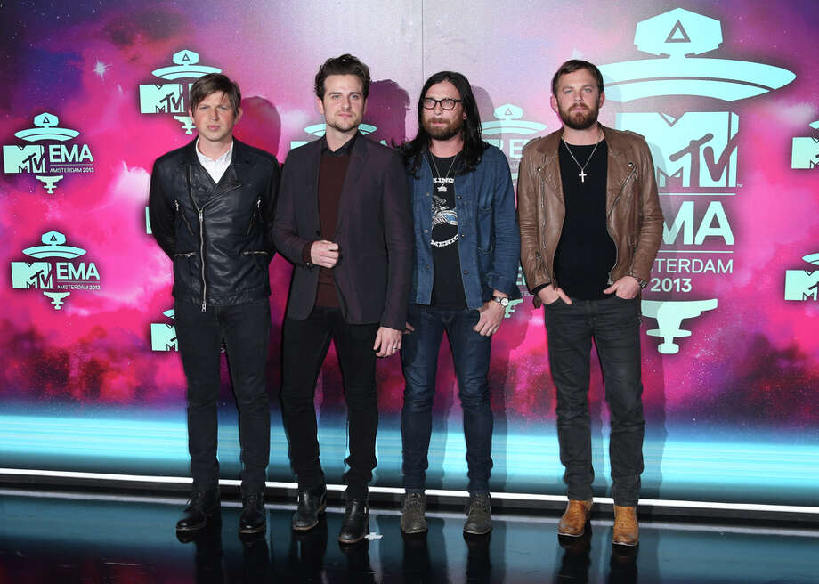 From left, Matthew Followill, Jared Followill, Nathan Followill and Caleb Followill of the band Kings of Leon pose for photographers upon arrival at the 2013 MTV Europe Music Awards, in Amsterdam, Netherlands, Sunday, Nov. 10, 2013. Photo: Joel Ryan, Associated Press / Invision