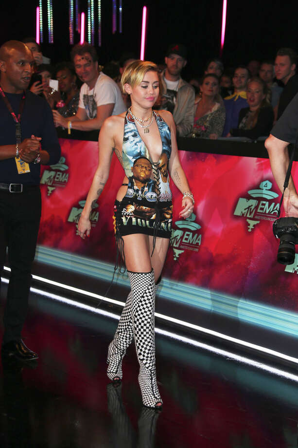 Miley Cyrus poses for photographers upon arrival at the 2013 MTV Europe Music Awards, in Amsterdam, Netherlands, Sunday, Nov. 10, 2013. Photo: Joel Ryan, Associated Press / Invision