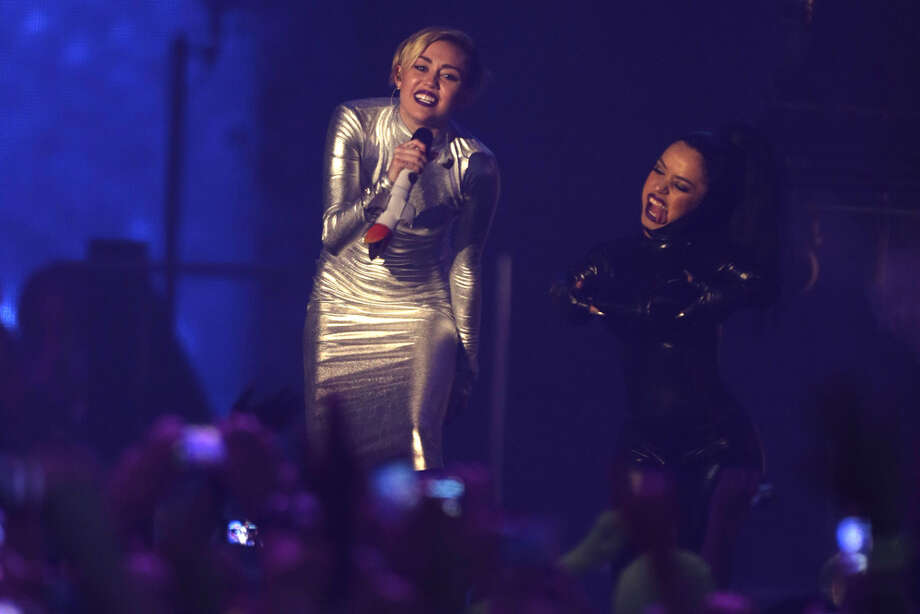Miley Cyrus, left, and a dancer perform at the 2013 MTV Europe Music Awards in Amsterdam, Netherlands, Sunday, Nov. 10, 2013. Photo: Peter Dejong, Associated Press / AP