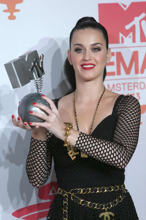 Katy Perry poses for photographers backstage with her award for Best Female at the 2013 MTV Europe Music Awards, in Amsterdam, Netherlands, Sunday, Nov. 10, 2013. Photo: Joel Ryan, Associated Press / Invision