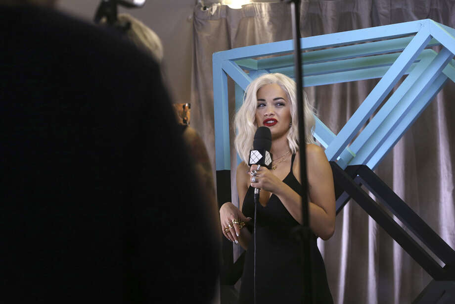 Rita Ora answers a reporters' questions  backstage at the 2013 MTV Europe Music Awards, in Amsterdam, Netherlands, Sunday, Nov. 10, 2013. Photo: Joel Ryan, Associated Press / Invision