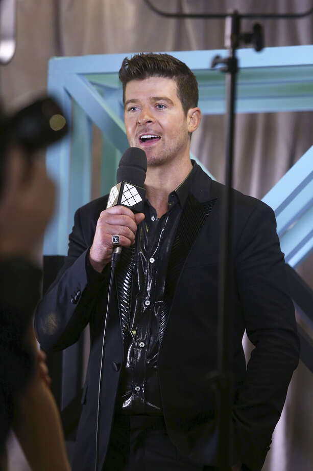 Robin Thicke answers a reporters' questions backstage at the 2013 MTV Europe Music Awards, in Amsterdam, Netherlands, Sunday, Nov. 10, 2013. Photo: Joel Ryan, Associated Press / Invision