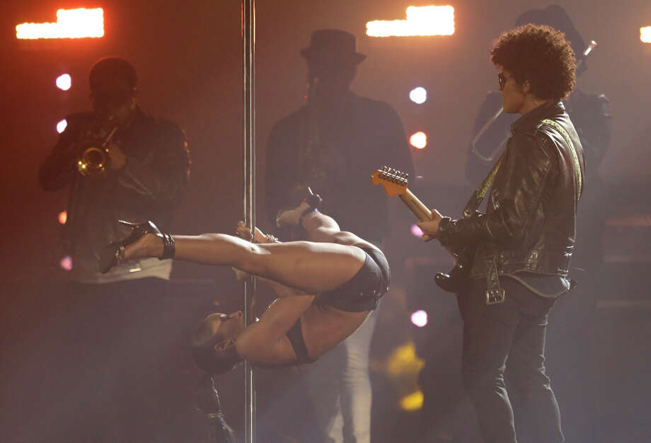 Bruno Mars, right, performs at the 2013 MTV Europe Music Awards in Amsterdam, Netherlands, Sunday, Nov. 10, 2013. Photo: Peter Dejong, Associated Press / AP