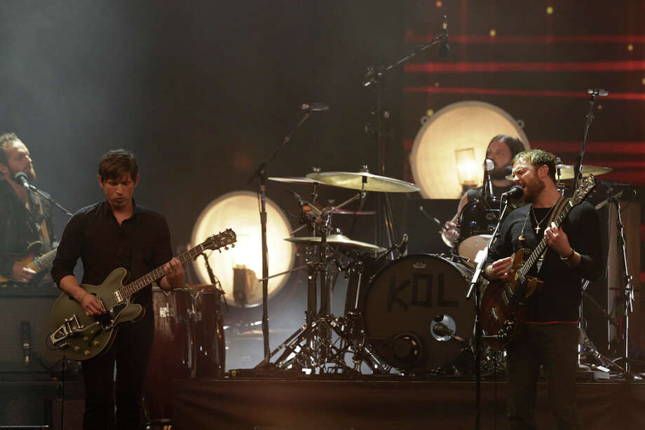 Kings of Leon, with Caleb Followill, right, perform at the 2013 MTV Europe Music Awards in Amsterdam, Netherlands, Sunday, Nov. 10, 2013. Photo: Peter Dejong, Associated Press / AP