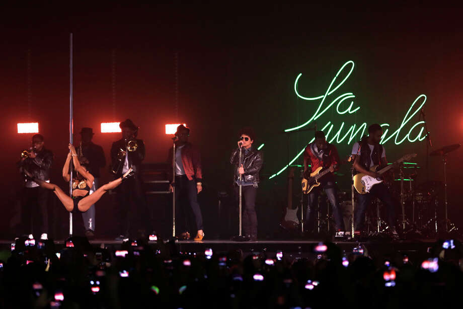 Bruno Mars, center, performs at the 2013 MTV Europe Music Awards in Amsterdam, Netherlands, Sunday, Nov. 10, 2013. Photo: Peter Dejong, Associated Press / AP