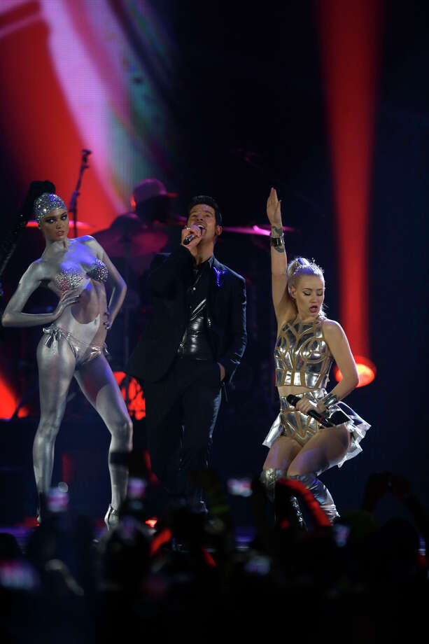 Robin Thicke, centre, and Iggy Azalea, right,  perform at the 2013 MTV Europe Music Awards in Amsterdam, Netherlands, Sunday, Nov. 10, 2013. Photo: Peter Dejong, Associated Press / AP