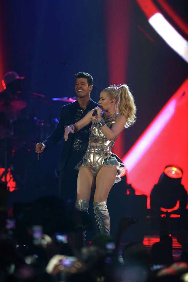 Robin Thicke, left, and Iggy Azalea, right,  perform at the 2013 MTV Europe Music Awards in Amsterdam, Netherlands, Sunday, Nov. 10, 2013. Photo: Peter Dejong, Associated Press / AP