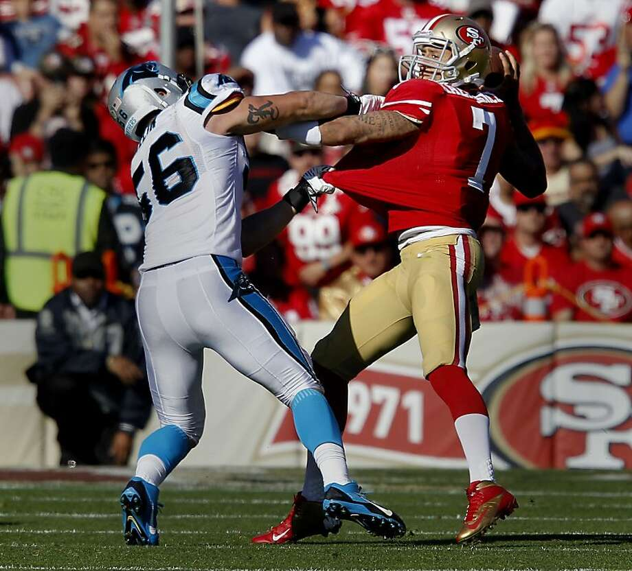 Carolina's A.J. Klein snares Colin Kaepernick for a sack - one of six for the Panthers - in the second quarter. Photo: Brant Ward, The Chronicle