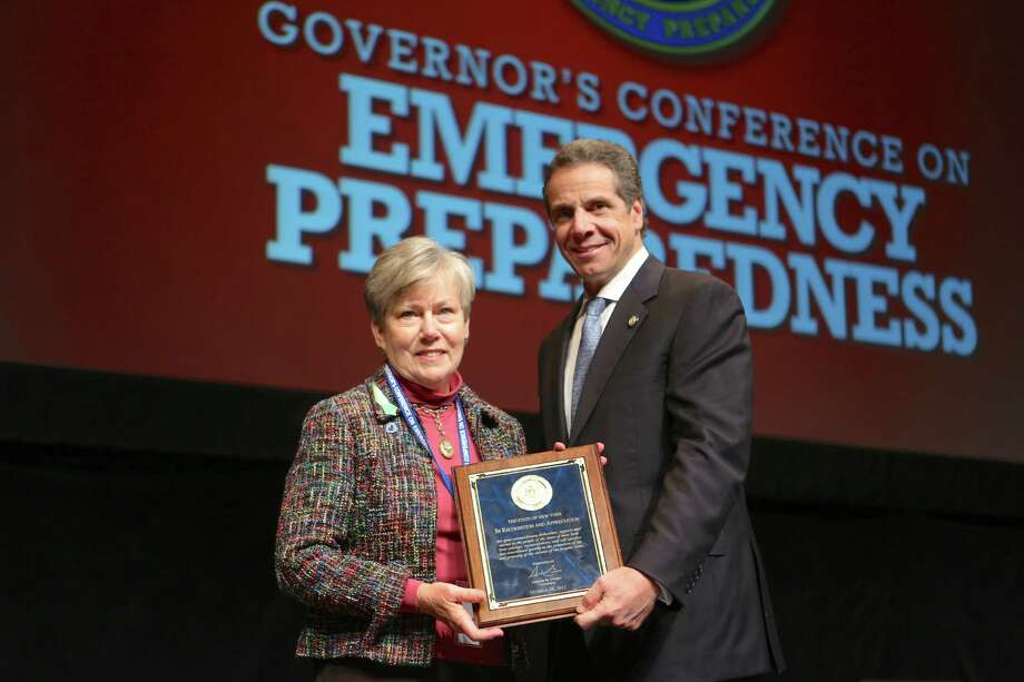 Schoharie Area Long Term?s (SALT) Executive Director Sarah Goodrich was presented with an award last month by Gov. Andrew Cuomo, one 16 recipients statewide honored for going above and beyond during the aftermath of storms that affected the state, including Irene and Sandy. (Submitted photo) / Judy Sanders - Office of the Governor