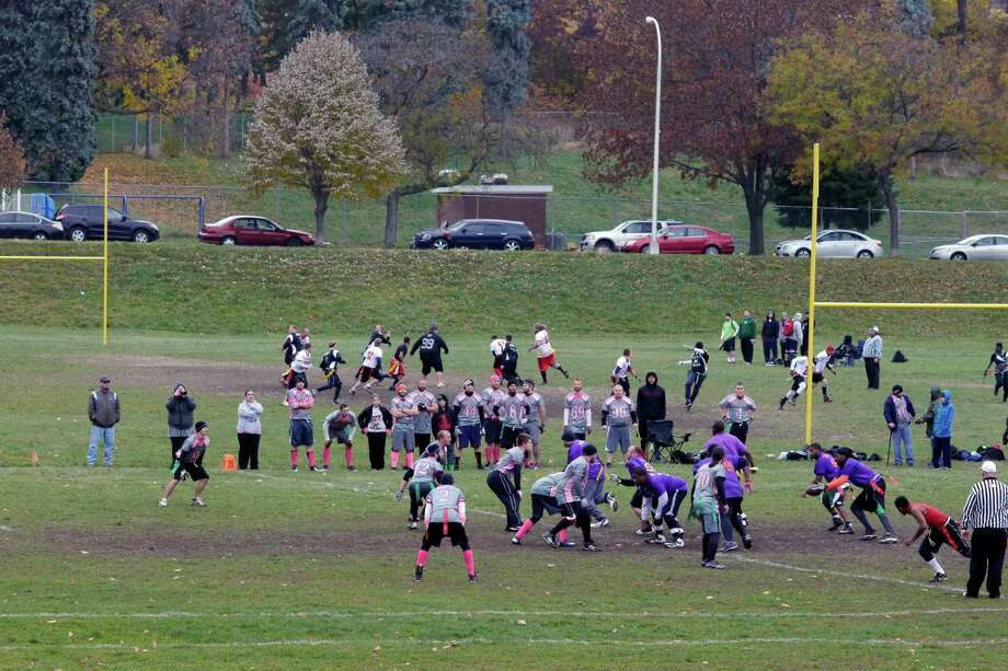 Teams take part in games during the final regular season games for the Capital District Flag Football League on Sunday, Nov. 10, 2013 at Lincoln Park in Albany, NY.  Next weekend the playoffs for the league begin.   (Paul Buckowski / Times Union) Photo: Paul Buckowski / 00024527A
