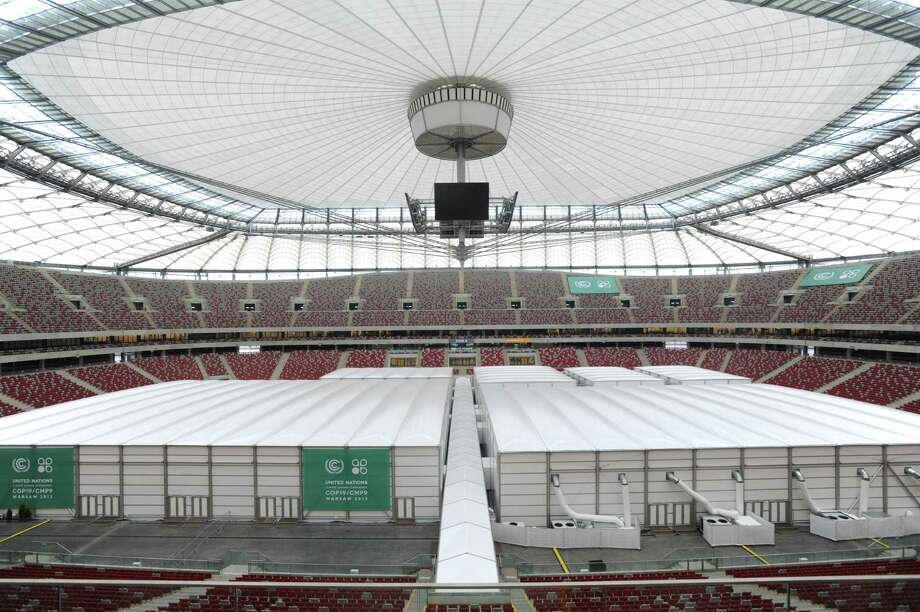 Special halls are set on the pitch of the National Stadium, the venue of the U.N. Climate Change Conference, in Warsaw, Poland, Sunday, Nov. 10, 2013. Climate envoys from rich countries, emerging economies and low-lying nations at risk of being swamped by rising seas will meet in Poland Monday for the next two weeks to lay the groundwork for a new global warming pact. (AP Photo/Alik Keplicz) ORG XMIT: XAK151 Photo: Alik Keplicz / AP
