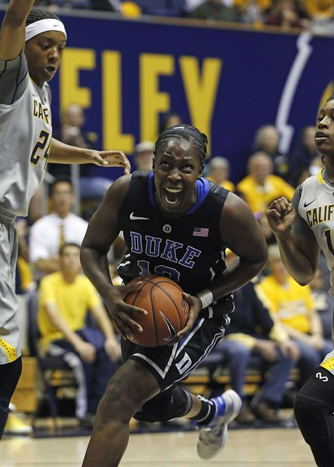 Duke guard Chelsea Gray drives to the basket between Cal's Courtney Range (left) and Mercedes Jefflo in the first half. Gray grew up in Manteca. Photo: George Nikitin, Associated Press