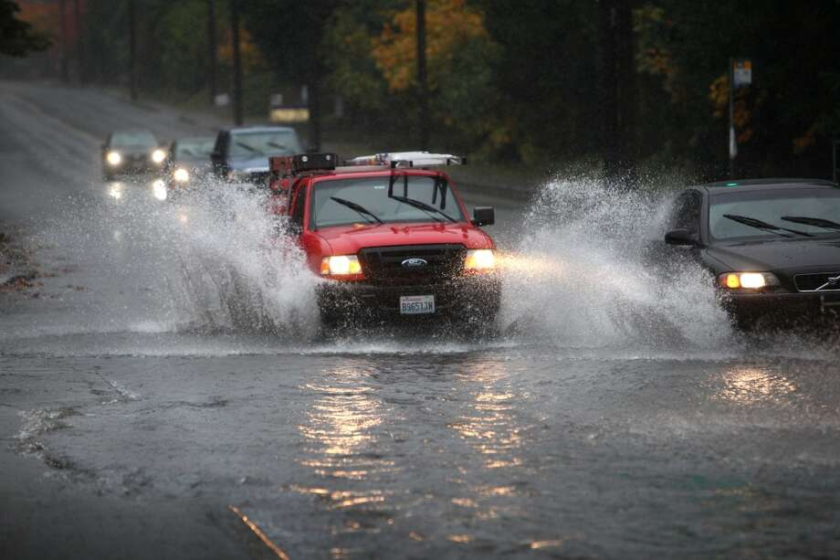 "Q: Are drivers required to turn on their headlights in the rain?  A: State Trooper Chris Webb:  ""This is an interesting question as the law gives discretion to police as to when headlights shall be used. According to RCW 46.37.020, 'every vehicle upon a highway' at 'half hour after sunset to a half hour before sunrise' shall have their headlights activated. The law become more subjective as headlights may be required at 'any other time when, due to insufficient light or unfavorable atmospheric conditions' exist. (In other) words, it could be illegal if you are not using your headlights when there is heavy rain and low light.  ""Personally, I like to be seen and use my lights nearly every time I drive, whether it is in my patrol car or personal car, day or night. I especially use my lights when driving on two-way roadways, where other drivers may look to pass or pull out from driveways.""  Dark headlights in headlight-worthy conditions can cost a driver $124. Photo: JOSHUA TRUJILLO, Seattlepi.com File"