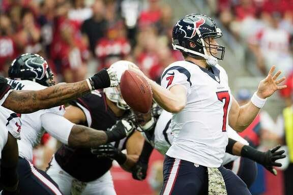 Houston Texans quarterback Case Keenum (7) fumbles as he tries to pass during the first half of an NFL football game at University of Phoenix Stadium on Sunday, Nov. 10, 2013, in Glendale, Ariz. ( Smiley N. Pool / Houston Chronicle )