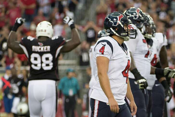 Texans kicker Randy Bullock (4) is dejected after missing a field goal - this one blocked by the Cardinals' Justin Bethel on the last play of the first half - for the ninth time this season. Bullock did make a 48-yarder.