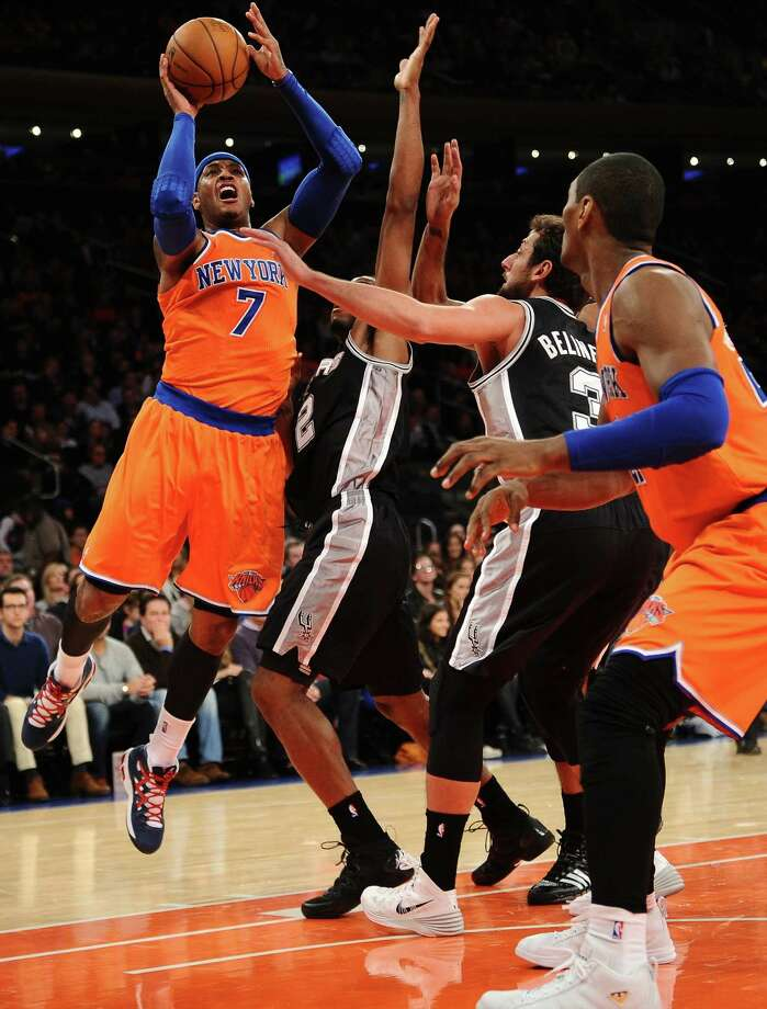 Knicks forward Carmelo Anthony (left) managed only 16 points vs. the Spurs, including Kawhi Leonard (2), who came off the bench, and Marco Belinelli. Photo: Maddie Meyer / Getty Images