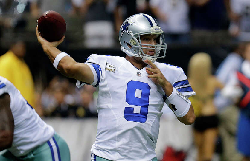 Dallas Cowboys quarterback Tony Romo (9) passes in the first half of an NFL football game against th