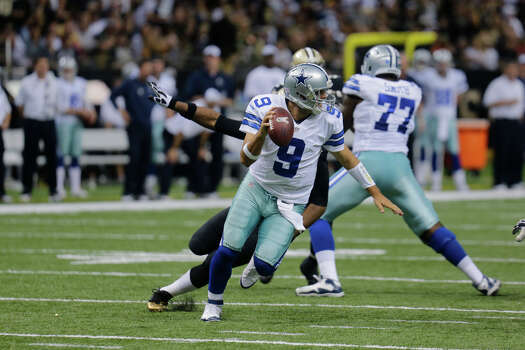 Dallas Cowboys quarterback Tony Romo (9) scrambles in the second half of an NFL football game against the New Orleans Saints in New Orleans, Sunday, Nov. 10, 2013. (AP Photo/Bill Haber) Photo: Bill Haber, Associated Press / FR170136 AP