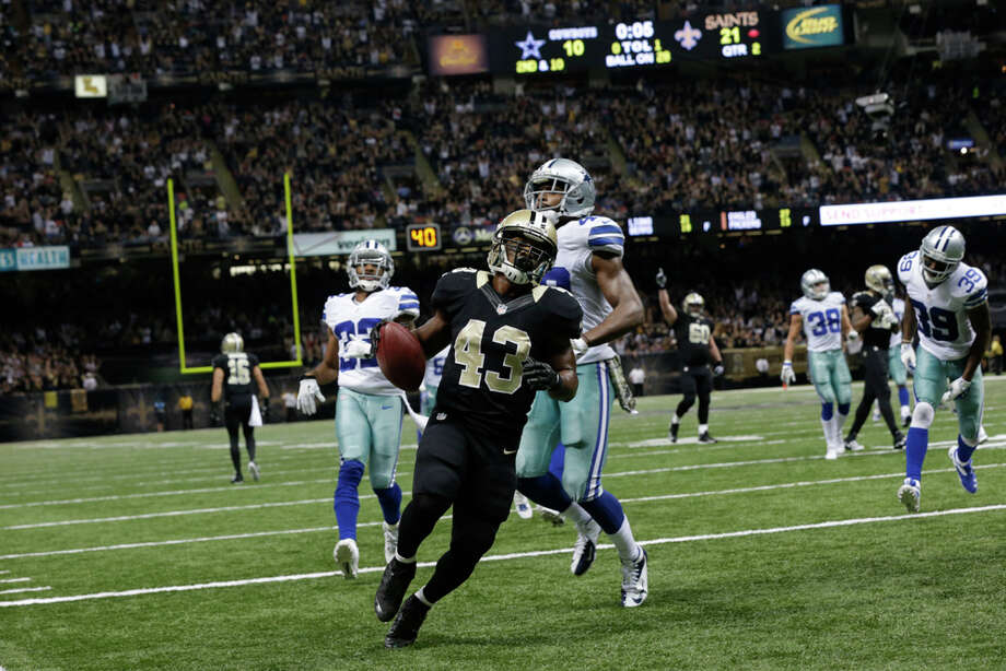 New Orleans Saints running back Darren Sproles (43) carries on a rushing touchdown in the first half of an NFL football game against the Dallas Cowboys in New Orleans, Sunday, Nov. 10, 2013. (AP Photo/Dave Martin) Photo: Dave Martin, Associated Press / AP