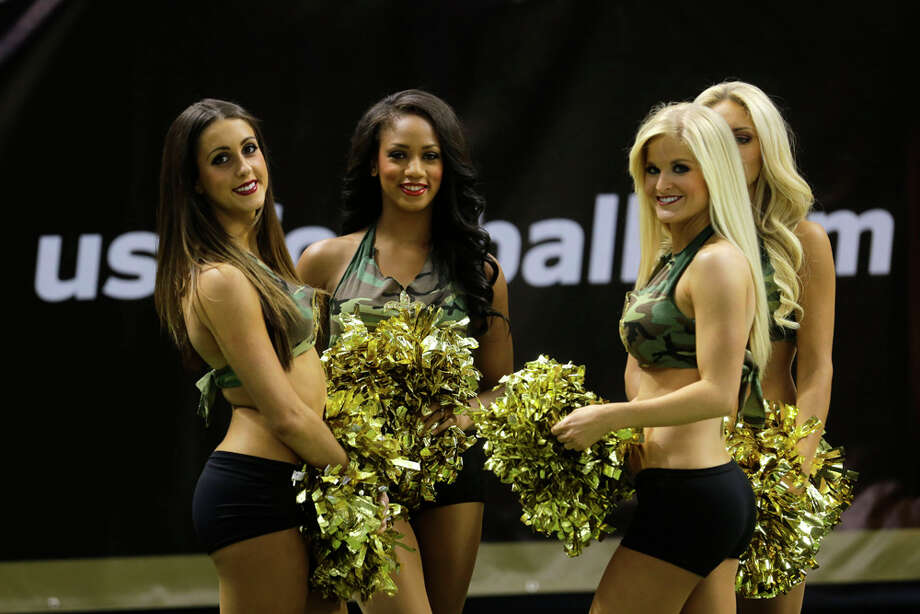 New Orleans Saints cheerleaders are seen with NFL Salute to Service uniforms before an NFL football game against the Dallas Cowboys in New Orleans, Sunday, Nov. 10, 2013. (AP Photo/Bill Haber) Photo: Bill Haber, Associated Press / FR170136 AP
