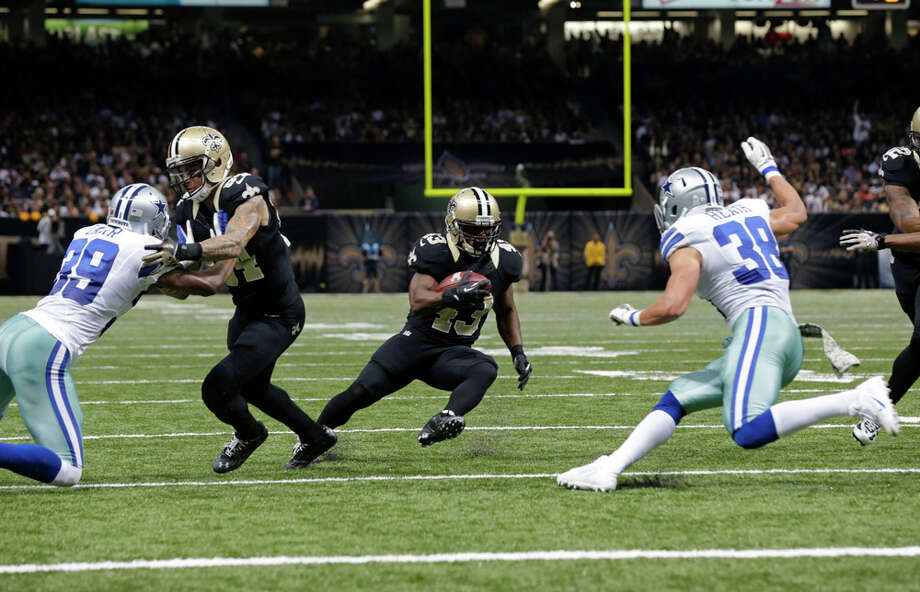 New Orleans Saints running back Darren Sproles (43) carries on  rushing touchdown in the first half of an NFL football game against the Dallas Cowboys in New Orleans, Sunday, Nov. 10, 2013. (AP Photo/Dave Martin) Photo: Dave Martin, Associated Press / AP