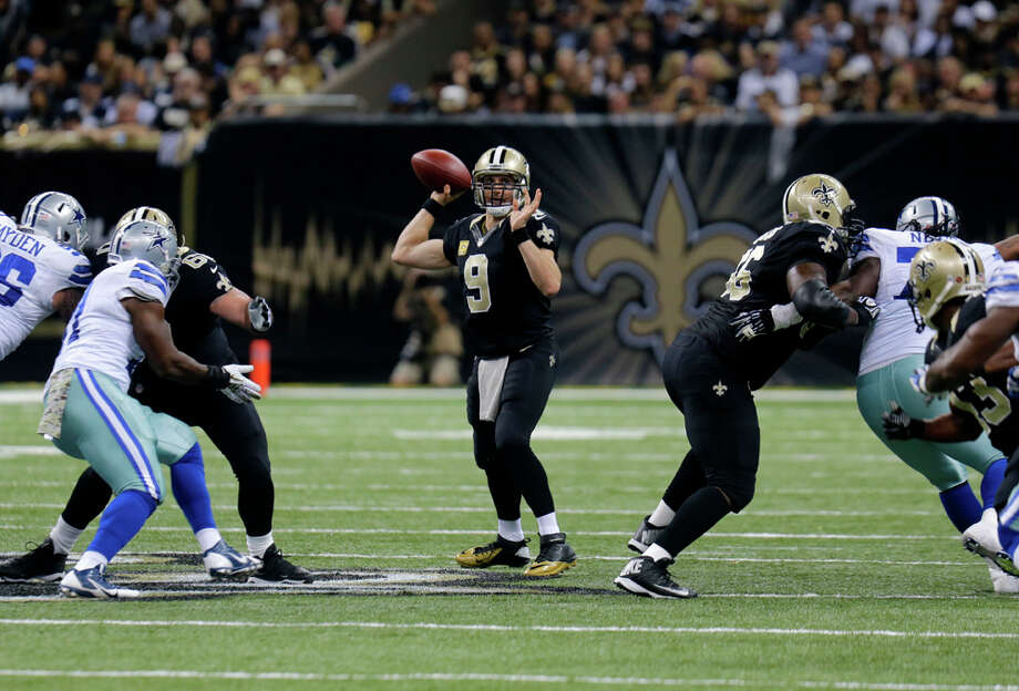New Orleans Saints quarterback Drew Brees (9) passes in the first half of an NFL football game against the Dallas Cowboys in New Orleans, Sunday, Nov. 10, 2013. (AP Photo/Bill Haber) Photo: Bill Haber, Associated Press / FR170136 AP