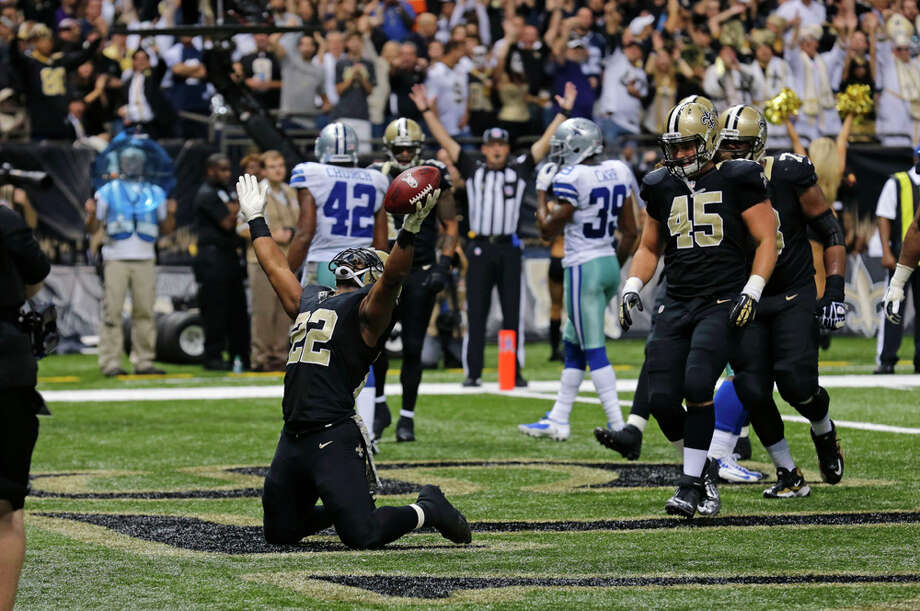 New Orleans Saints running back Mark Ingram (22) celebrates his touchdown in the second half of an NFL football game against the Dallas Cowboys in New Orleans, Sunday, Nov. 10, 2013. (AP Photo/Bill Haber) Photo: Bill Haber, Associated Press / FR170136 AP